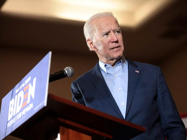 Biden makes first general election stop in Iowa, where COVID cases are rising
