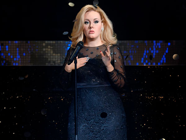 Adele flaunts slim figure in leopard dress at Oscars after-party
