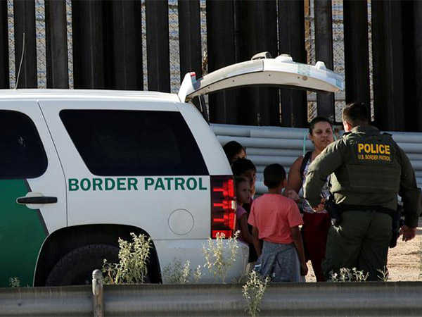 13 Marines charged in human smuggling case