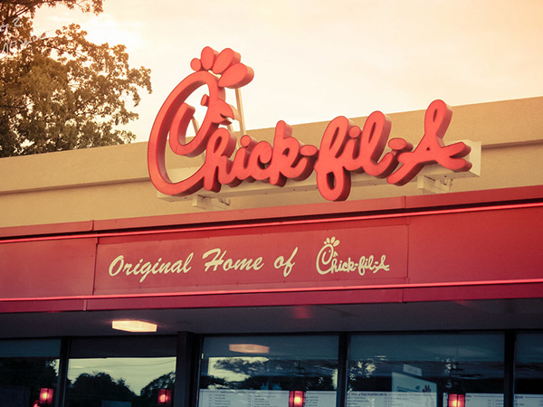 Chick-fil-A customer desperately tries to escape high chair after sitting in it on a dare