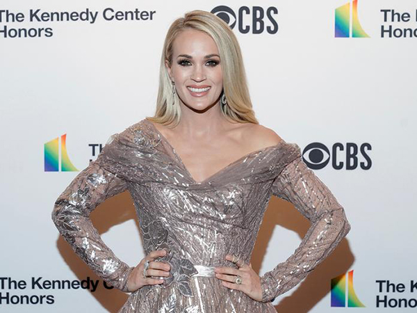 Carrie Underwood says son, 4, thinks she's 70, her job is to 'wash the laundry' in hilarious school assignment