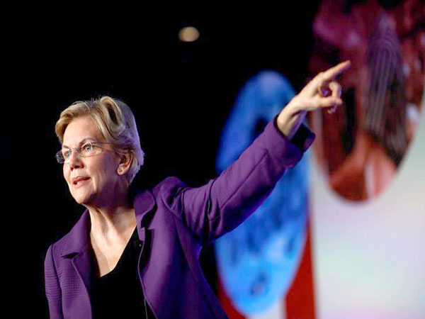 Warren rolls out plan that would ban federal judges from owning or trading individual stocks