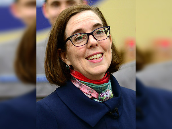 Oregon governor tells residents to call cops on people violating COVID restrictions