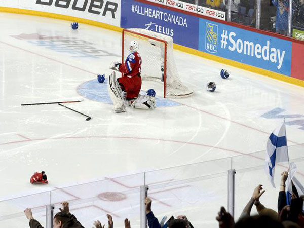 Canada routed by Russia, top prospect Lafreniere injured in loss