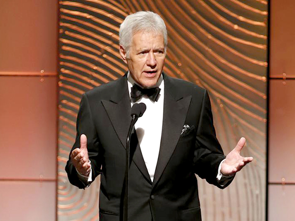 Alex Trebek 'on the mend' and back on the job for Jeopardy