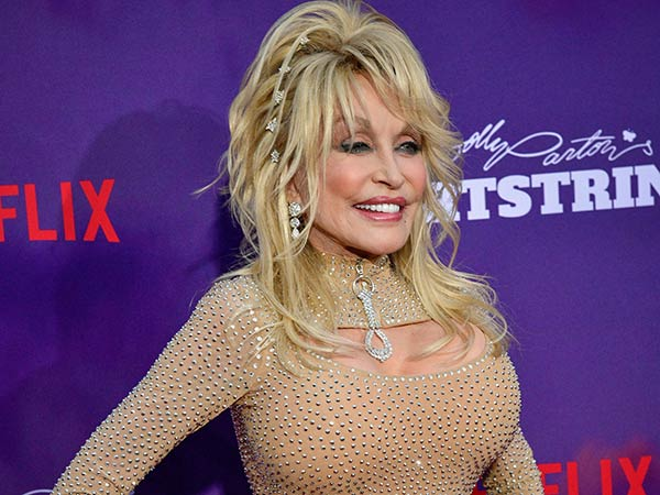 Dolly Parton says her tattoos are tasteful