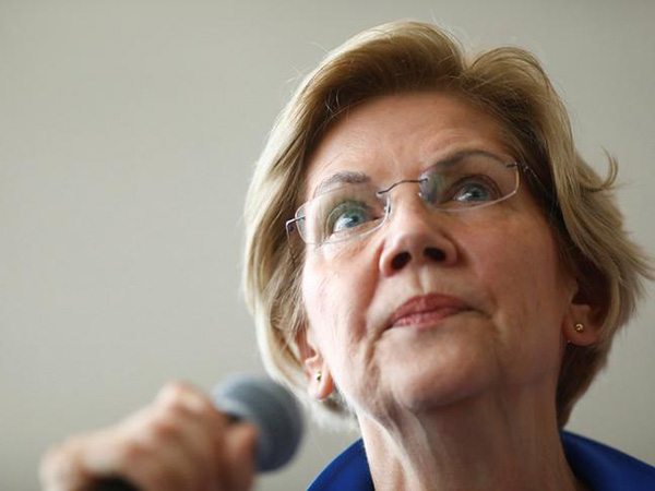 Warren, at Iowa town hall, likes 'frame' of question on 'US-supported murder