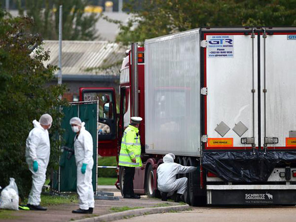 Driver in UK truck deaths charged with 39 manslaughter counts