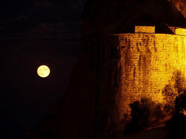 Full moon casts a glow by Greece's Koroni castle