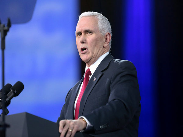 Pence urges people to wear masks as US cases surge