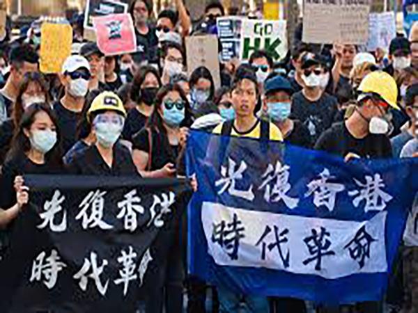 Thousands protest proposed legislation in HK