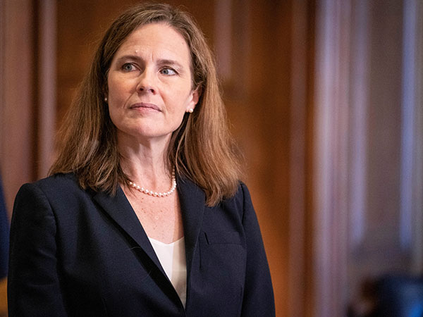 Senate leadership exchange angry jibes after the vote to advance Amy Coney Barrett