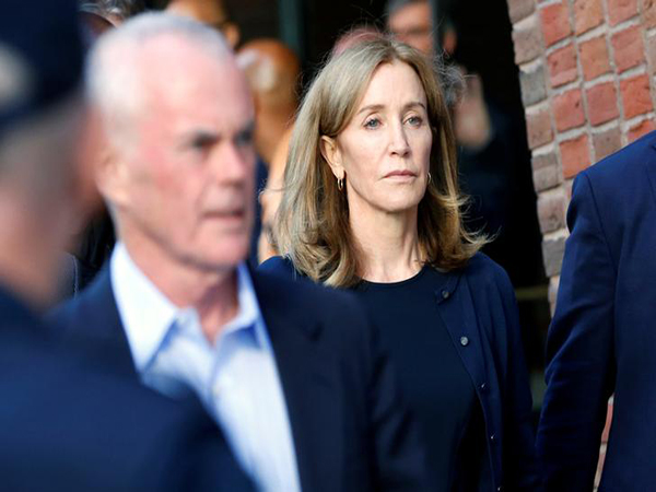 Felicity Huffman gets prison time for paying off SAT fixer in college admissions scheme