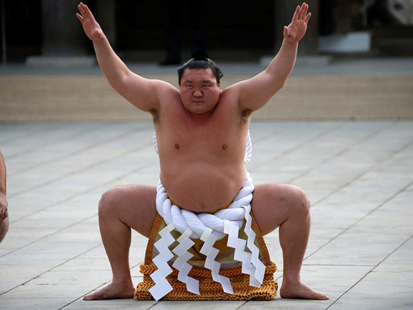 Japan's sumo superstar Hakuho tests positive for COVID-19