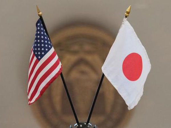 Japan, US extend trade talks by one day