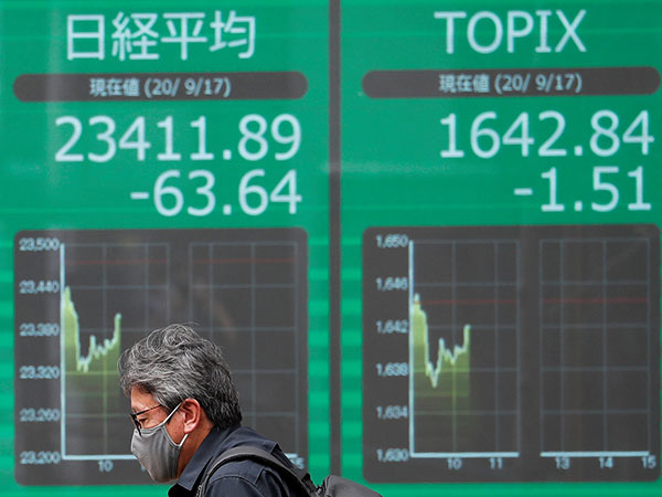 Tokyo stocks drop in morning after U.S. shares tank overnight