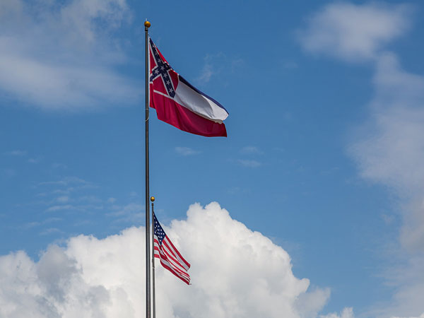 U.S. Mississippi governor signs bill to remove Confederate emblem from state flag