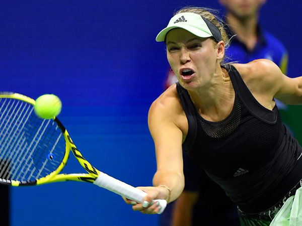 Defending champ Wozniacki out, top seeds advance to China Open finals