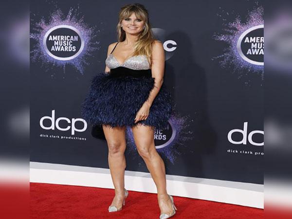Heidi Klum shares racy butt-baring spanking pic on