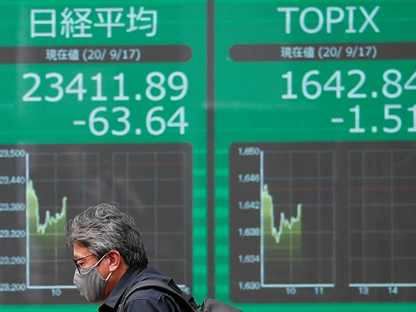 Tokyo stocks closed mixed on hopes for economic recovery, ex-dividend selling