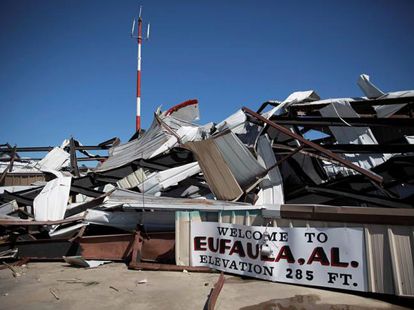 'We're hurting': Alabama town mourns victims of deadly tornado
