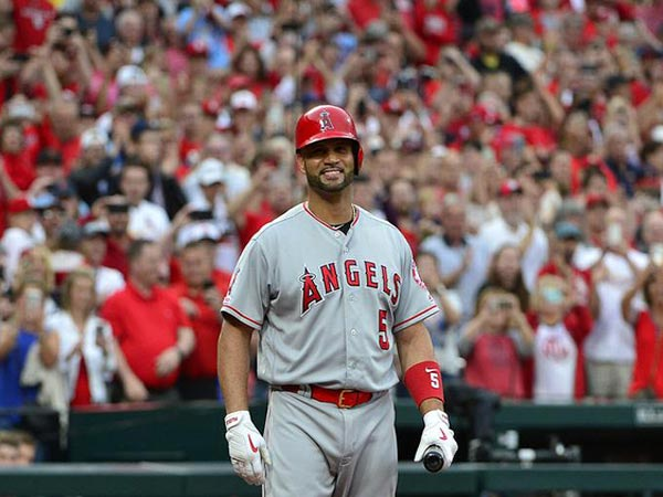 Baseball legend Albert Pujols takes the jersey off his back for young fan with Down syndrome