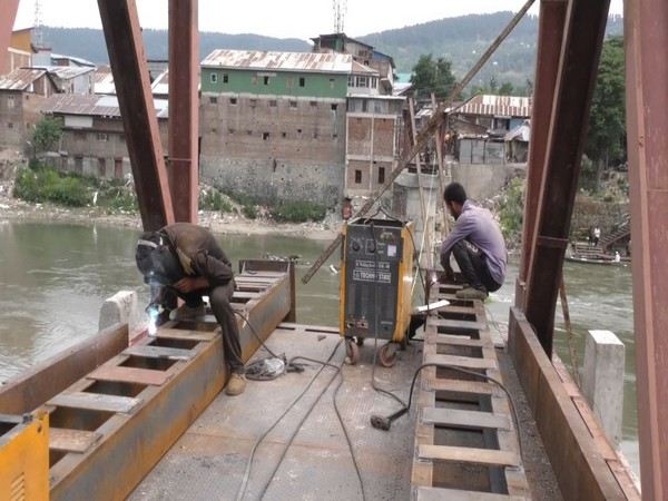 Re-construction of battered wooden footbridge in Baramulla all set to complete
