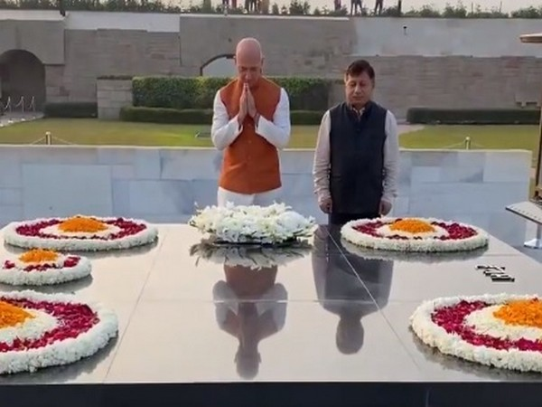 Bezos (with folded hands) at Rajghat in New Delhi on Tuesday