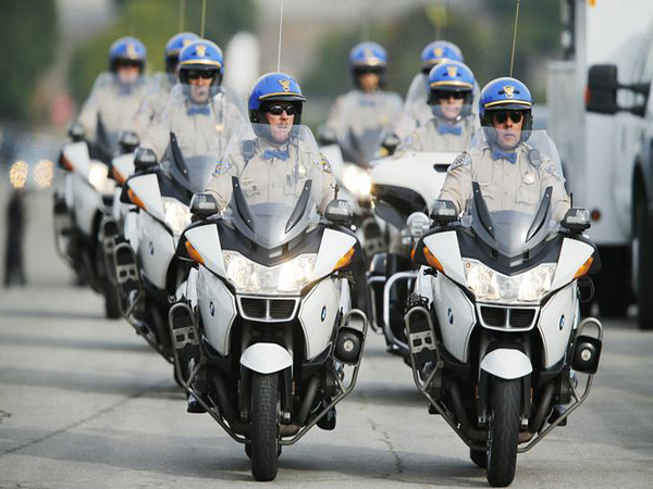 California motorcycle officer involved in crash dies