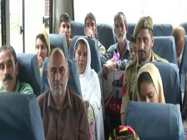 As many as 40 Pakistan occupied Kashmir (PoK) residents crossed border through Cross-LoC bus service. (Photo/ANI)