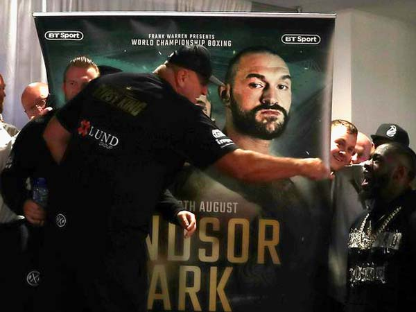 Deontay Wilder gatecrashes Tyson Fury weigh-in to trade insults with rival