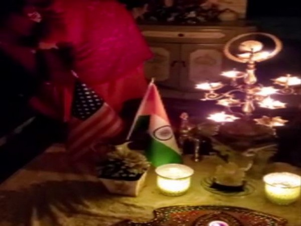 Indian-American community members in New Jersey light diyas on Sunday night