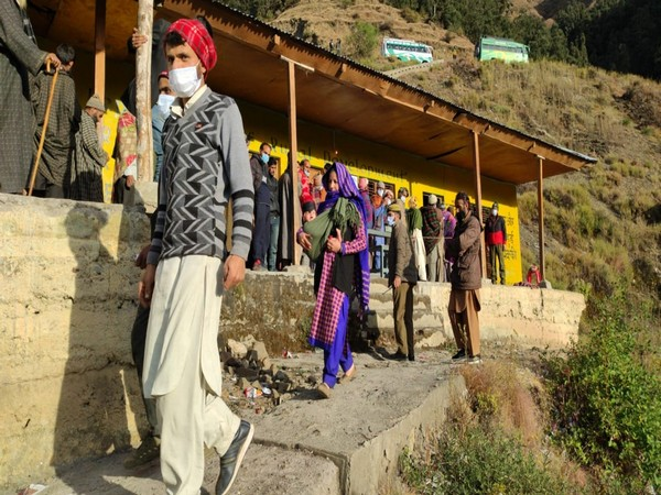 Many line up outsids th Sungri polling station in Chassana area of the Reasi district. (Photo/ANI)