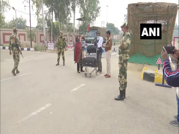 Stranded people in Pakistan return to India through Attari border. (Photo/ANI)