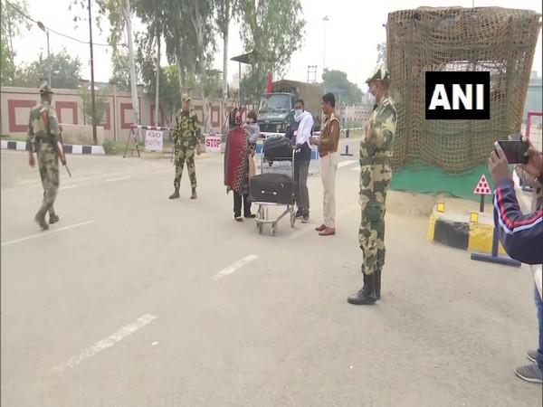Stranded people in Pakistan return to India through Attari border. (Photo/ANI)