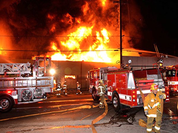 Over 130 firefighters work to extinguish large structural fire in downtown Los Angeles
