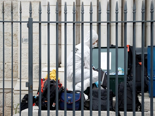 A forensic specialist inspects the scene of a reported knife attack at Notre Dame church in Nice, France, October 29, 2020. (Picture Credit: REUTERS)