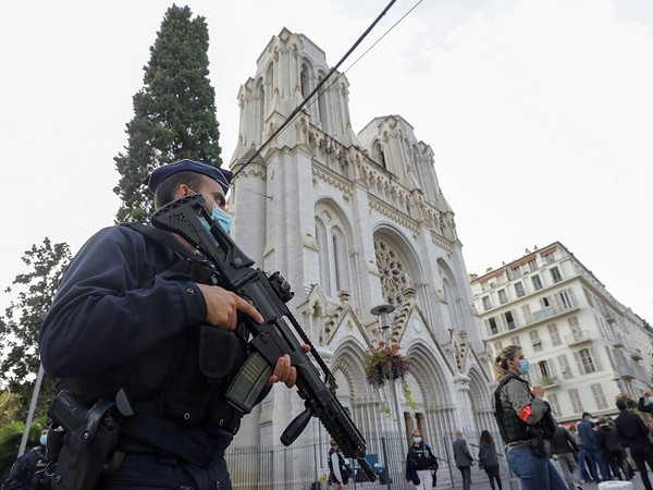 A police officer stands near Notre Dame church, where a knife attack took place, in Nice, France October 29, 2020. (Photo Credit: REUTERS)
