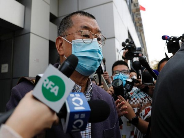 Apple Daily founder Jimmy Lai Chee-ying leaves from a police station in Hong Kong on Friday