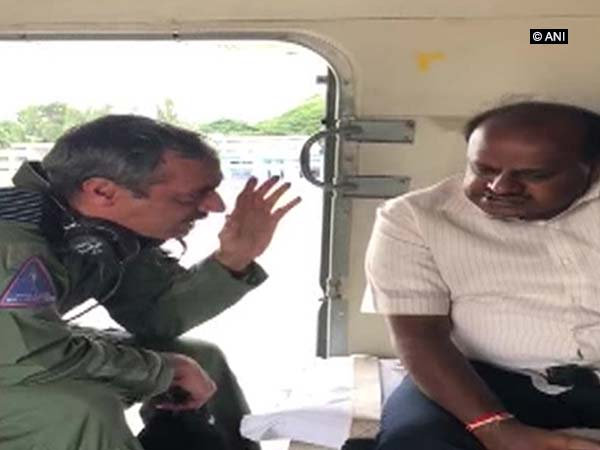 K'taka CM conducts aerial survey of flood, landslide affected areas