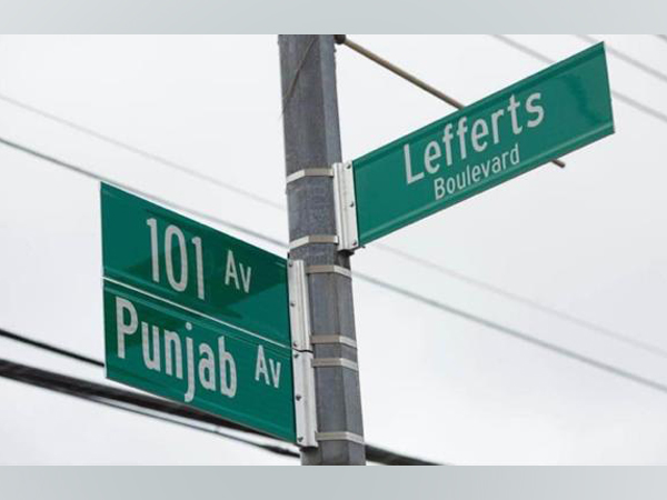 Street sign of Punjab Avenue at the intersection of Lefferts Boulevard and 101 Avenue