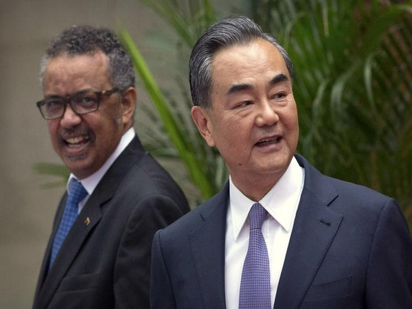 Tedros Adhanom Ghebreyesus, left, Director General of the World Health Organization (WHO), smiles as he arrives for a meeting with Chinese Foreign Minister Wang Yi,