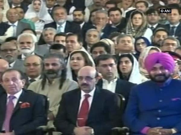 Navjot Singh Sidhu seated next to President of PoK Masood Khan