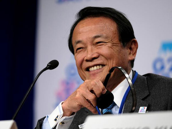 Aso urges China to help make rules on loan offers