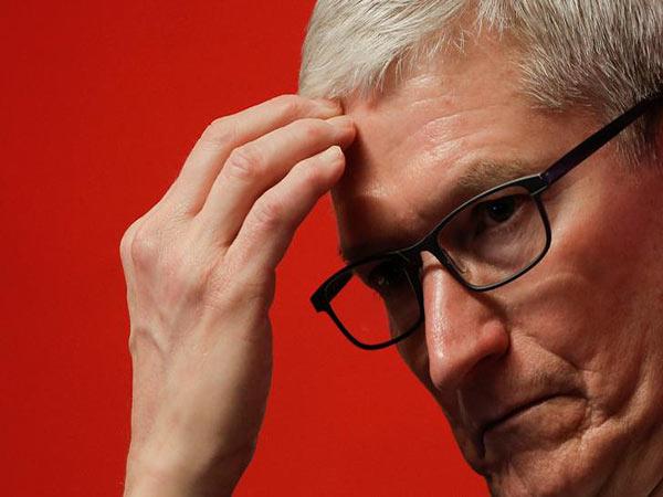 Tim Cook 'thrilled' Berkshire's Buffett owns Apple stock