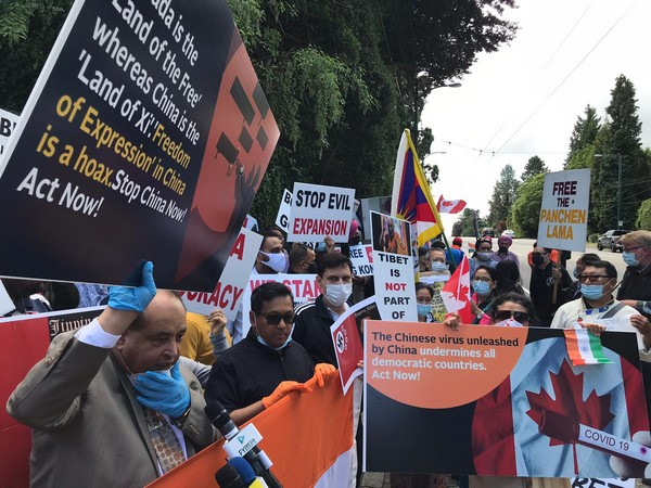 Protestors gather outside the Chinese consulate in Vancouver on Saturday.