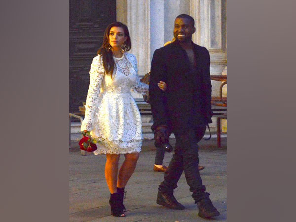 American rapper Kanye West (R) and wife Kim Kardashian (L) (File photo)