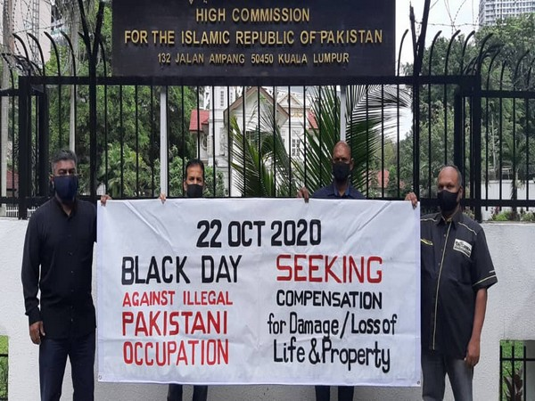 People protesting against Pakistan's invasion of Jammu and Kashmir on October 22, 1947, in front of the Pakistan Embassy in Malaysia on Thursday.