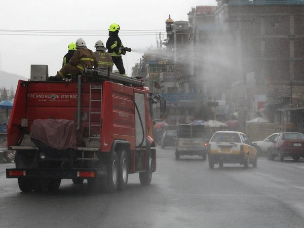 A vehicle spraying disinfectant along a street to prevent the spread of the coronavirus in Kabul