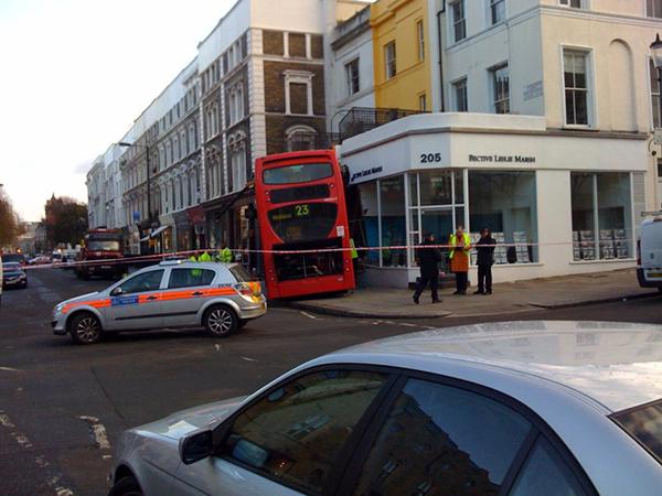 Double-decker London bus crashes into front garden